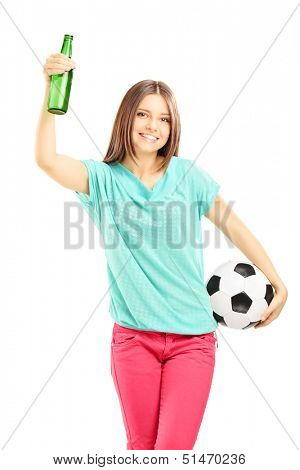 Happy female fan holding a soccer ball and beer bottle isolated on white background