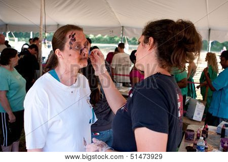 Woman Gets Zombie Makeup Applied At Scary 5K Race