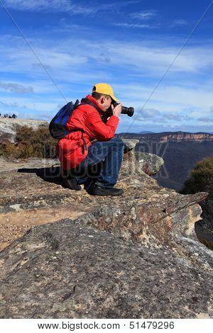 Photographer Taking Photos Of Mountain Landscape