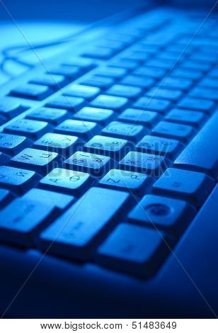 Computer Keyboard In Blue Light