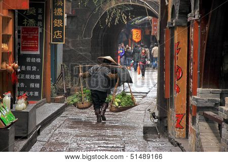 Chinese Woman Carrying Vegetables