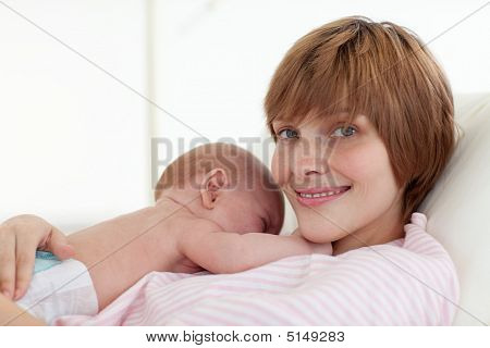 Mother Embracing Her Newborn Baby