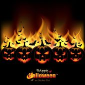 Jack O'Lanterns in front of Flames - EPS 10