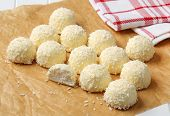 stock photo of bonbon  - white chocolate bonbons with coconut - JPG