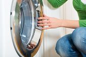 foto of housekeeper  - Young woman or housekeeper has a laundry day at home - JPG