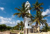 Scenic view at white lighthouse in Galle fort Sri Lanka during sunny day