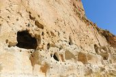 stock photo of pueblo  - Cliff dwelling of the ancient Pueblo indians at Bandelier National Park - JPG