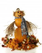 A snowman-style lady composed of 3 pumpkins.  She's wearing a straw hat, multi-colored scarf and has