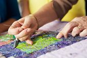 stock photo of quilt  - Close Up Of Woman - JPG