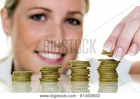 a young woman stacks coins. save icon photo for growth precaution.