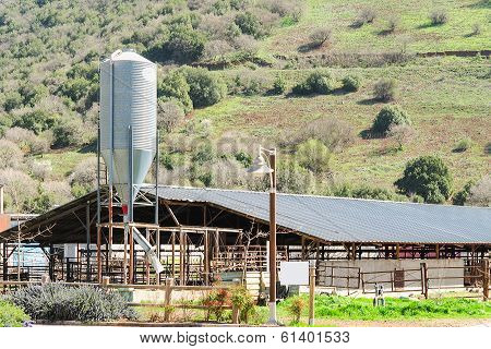 Rustic Cowshed With Silo In The Countryside