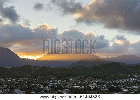 Rays of sun over mountain range