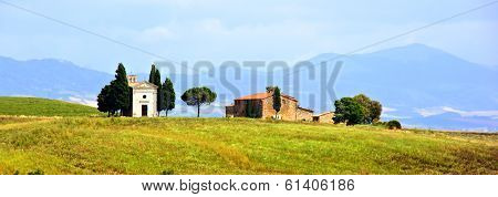 Rural Tuscan church and house