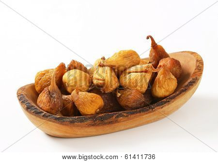 portion of dried figs served on the wooden tray