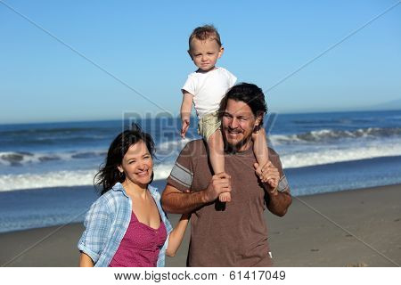 Young family playing at the beach