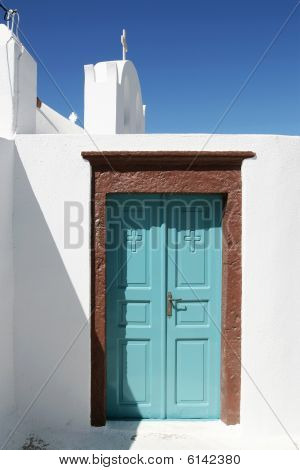 Turquoise Doorway With Brown Framing