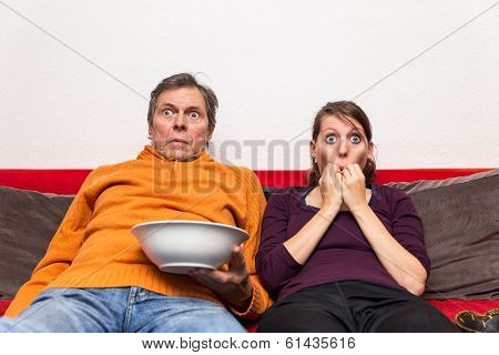Family Watching A Creepy Movie