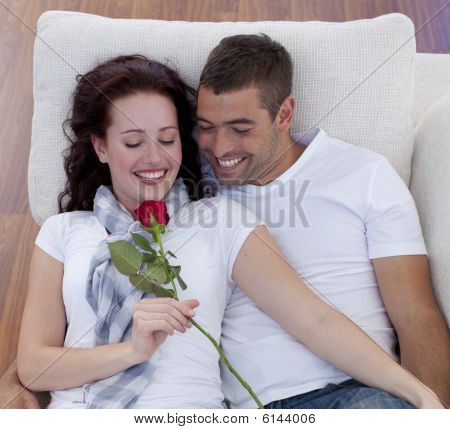 Portrait Of Lovers On Sofa With A Rose