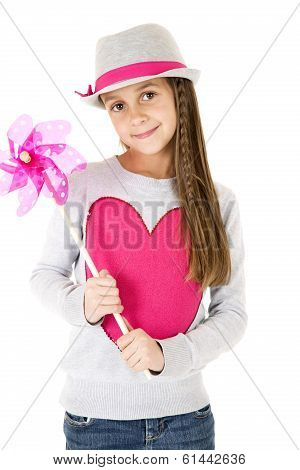 Cute Girl Model Holding A Toy Pinwheel Smiling