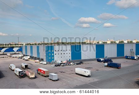 Warehouse Logistics Complex With Unloading Docks And Truck Parking Space.