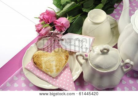 Pink Theme Happy Mothers Day Breakfast In Bed With Tea Cup And Tea Pot, Roses And Heart Shape Toast