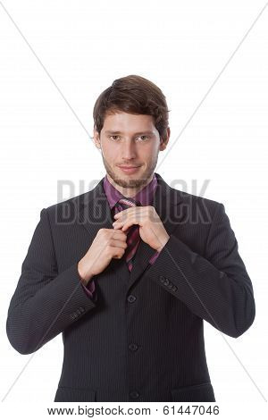 Successful Man Correcting Tie