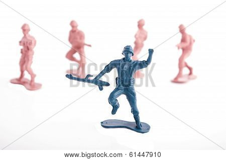 toy blue and pink soldiers on a white background