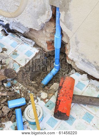 Repairs Of Home Clean Water Plumbing Tube And Heavy Hammer And Related Tool