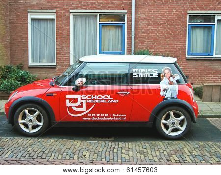 Advertisement On A Car That Stands In The Street In Gorinchem. Netherlands
