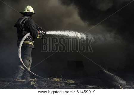 Fireman Putting Out A House Fire