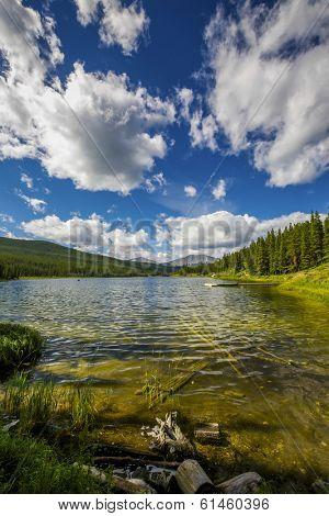 Tranquil lake in the pristine Alberta wilderness.