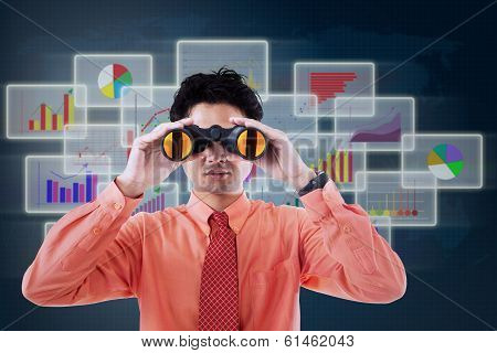 Businessman Using Binoculars For Finding Business Profit