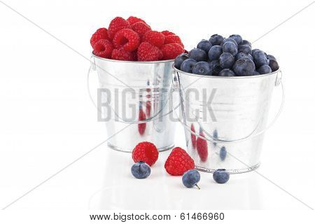 Blueberry And Raspberries Berries In A Metal Bucket, Isolated On White Background