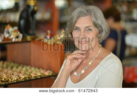 mature woman in jewelry store