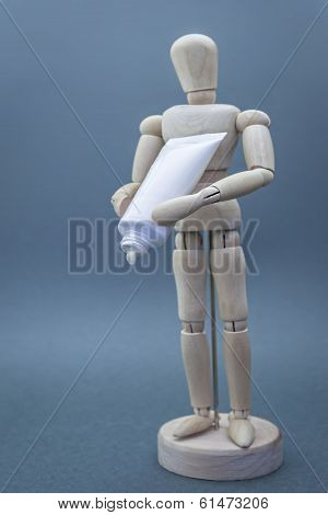 Articulated wooden doll with packing cremates isolated on blue background