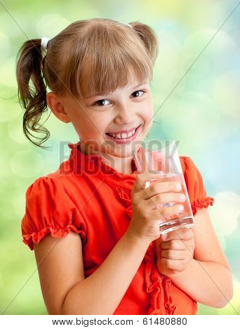 Schoolgirl portrait with water glass outdoor