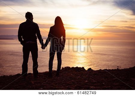 Lovers Looking Sunset Over The Sea