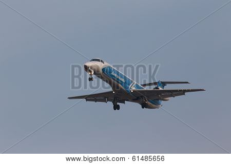 Dniproavia Airlines Embraer ERJ-145LR aircraft on the blue sky background
