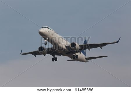 Air Astana Airlines Embraer 190 aircraft on the blue sky background