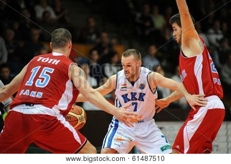 KAPOSVAR, HUNGARY - MARCH 8: Hrvoje Puljko (white 7) in action at a Hungarian Championship basketball game with Kaposvar (white) vs. Paks (red) on March 8, 2014 in Kaposvar, Hungary.