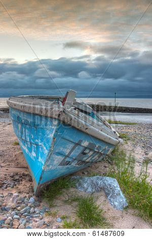 Damaged Fishing Boat On The Empty Beach In Morecambe, Hdr Image