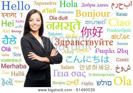 Young, confident, successful and beautiful business woman over the background with a world languages