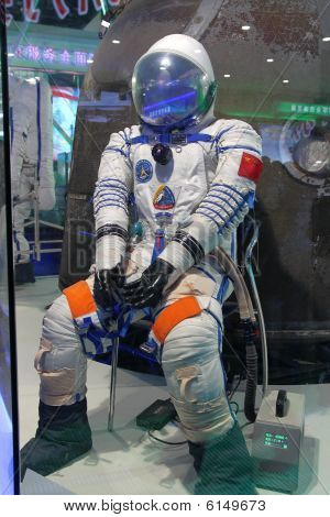 Shenzhou 7 Astronaut's spacesuit on display in Beijing, China. The re-entry capsule is at the back.