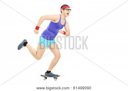 Nerdy guy riding a small skateboard isolated on white background