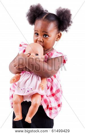 Cute Little African American Girl Holding A Dol