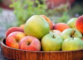 pic of healthy food  - green and red apples in wooden tray outdoor - JPG