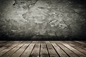 Wooden ground with grunge wall background.