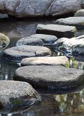 stock photo of koi  - Zen stone path in a Japanese Garden - JPG