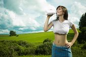 stock photo of milkmaid  - girl in a t - JPG