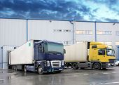 pic of semi trailer  - Unloading cargo truck at a warehouse building - JPG